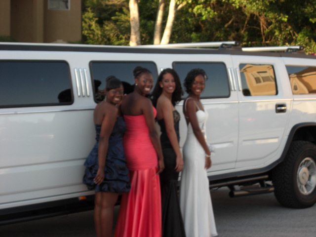 Prom Girls pose with Hummer H2 Limo