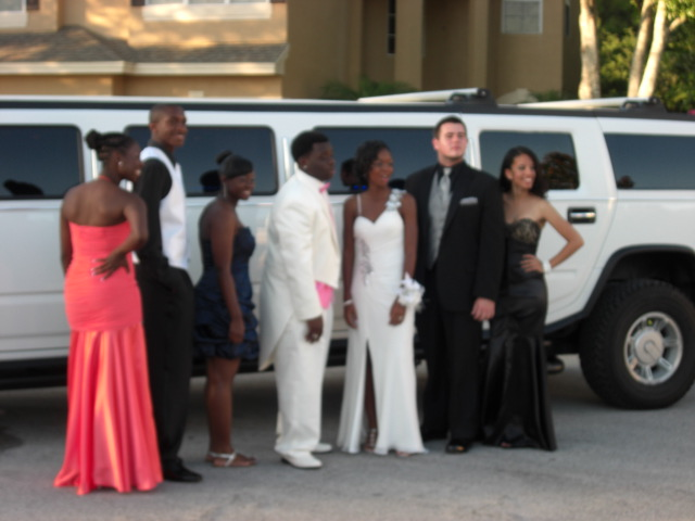 Prom group poses with Hummer H2 Limo